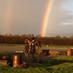 Holly riding at Annie O Gradys under a double rainbow!
